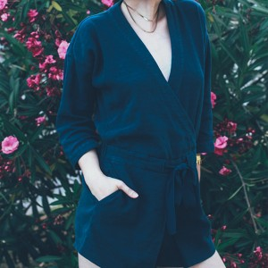 The Stylish Wanderer wearing a wrap style romper